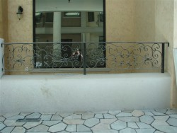 Decorative Iron Railing on Stub Wall